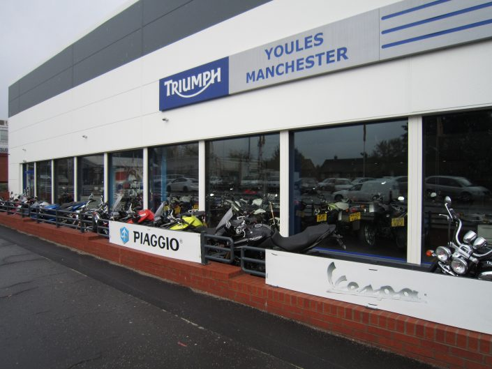 Recent aluminium shopfront installation Triumph Headquarters