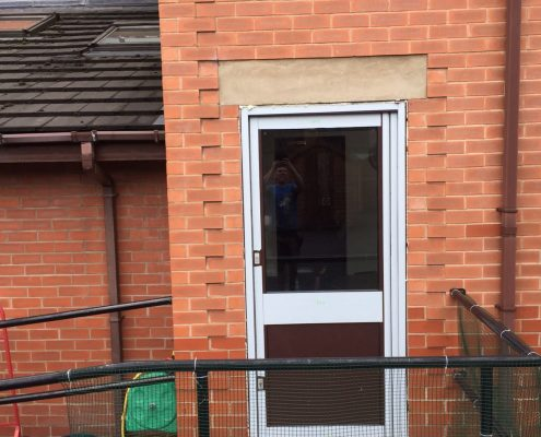 aluminium fire exit door installation to school in Preston