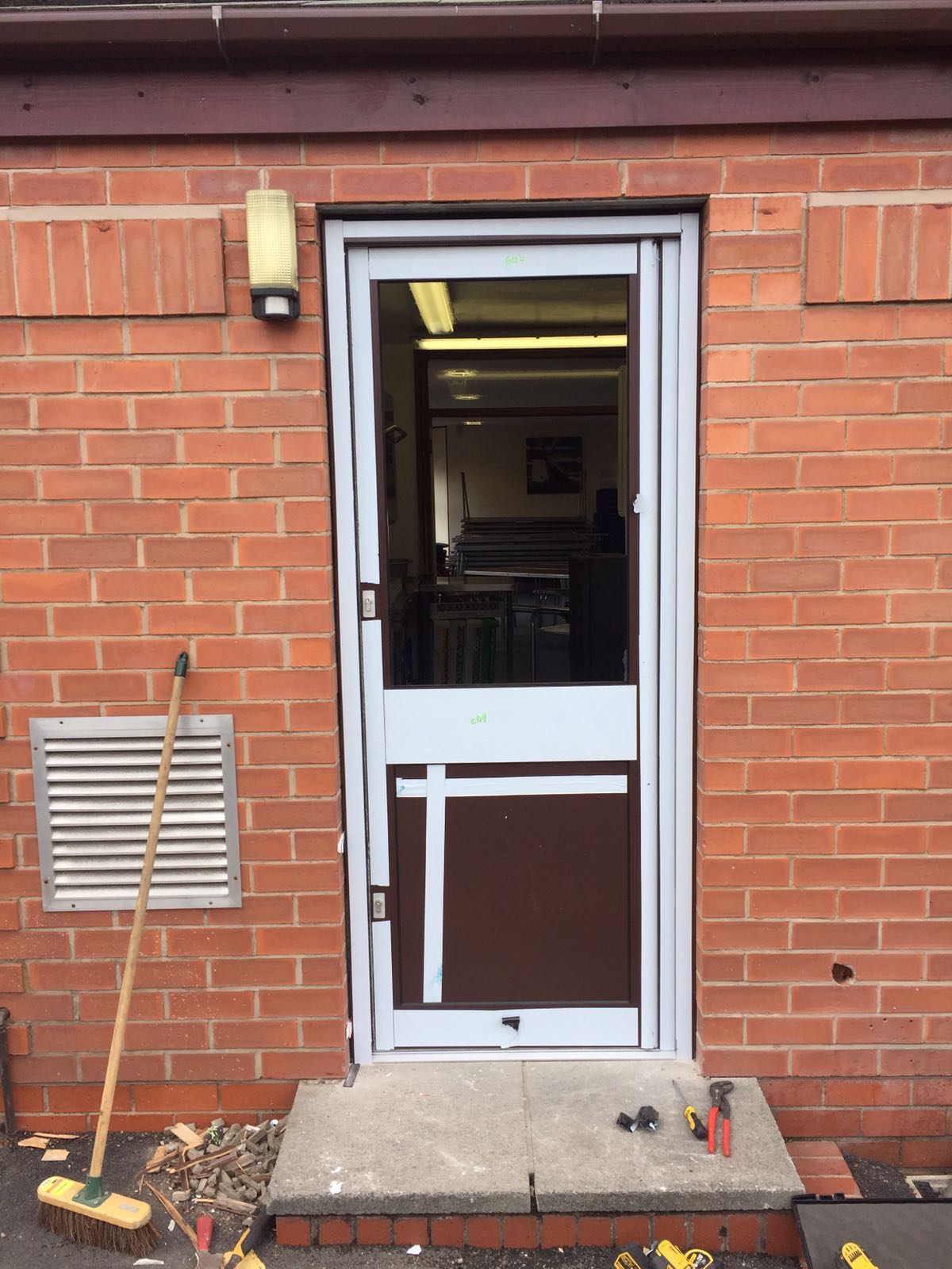 aluminium door refit to a school in Preston