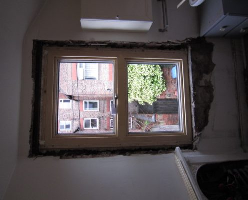 taking out the wood framed windows